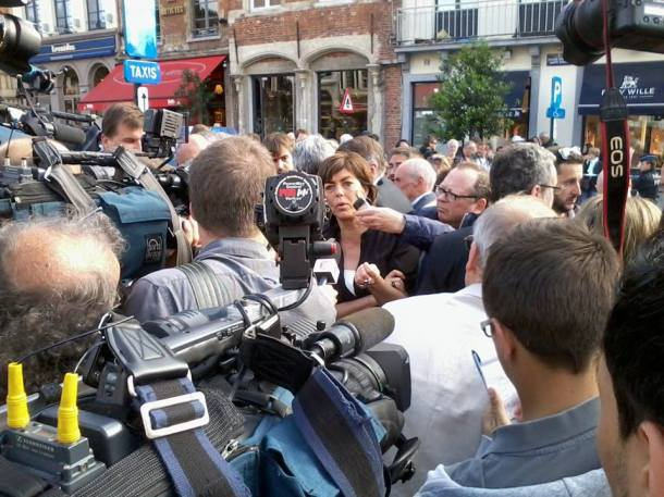 Joëlle Milquet, Interior Minister, is talking with the media shortly after the attack has taken place.